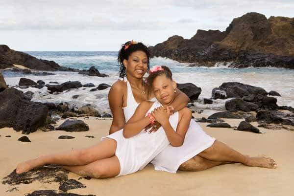 Mother and Daughter wearing all white clothes for a photo shoot at Eternity Beach, Oahu, Hawaii